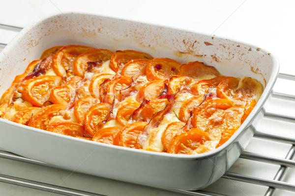 tomatoes baked with mozzarella cheese and pancetta Stock photo © phbcz