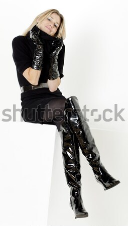 woman wearing extravagant clothes holding a whip Stock photo © phbcz