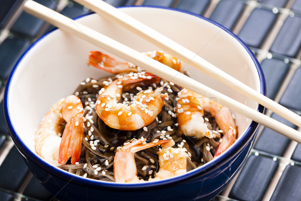 Japanese buckwheat noodles with prawns, soya sauce and sesame Stock photo © phbcz