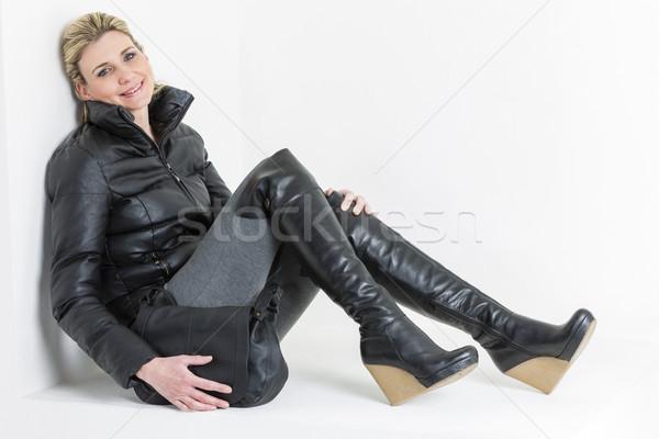 woman wearing platform black boots with a handbag Stock photo © phbcz