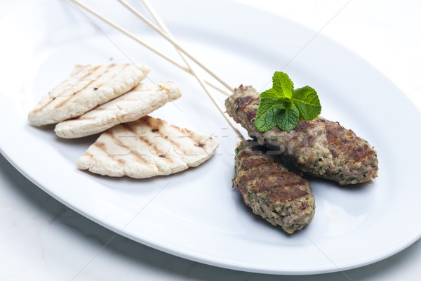 mutton kebab with mint and pita bread Stock photo © phbcz
