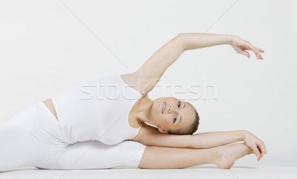 Stock photo: portrait of ballet dancer doing stretching