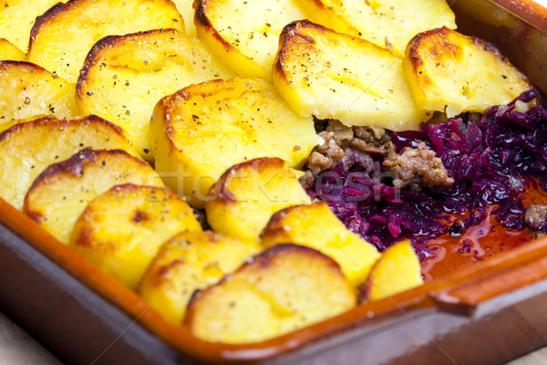 Stock photo: potatoes baked with pork minced meat and red cabbage