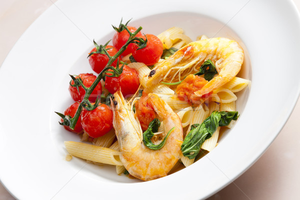 pasta penne with prawns, spinach and grilled cherry tomatoes Stock photo © phbcz