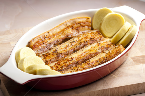 baked pork belly on cumin with potato dumlings Stock photo © phbcz