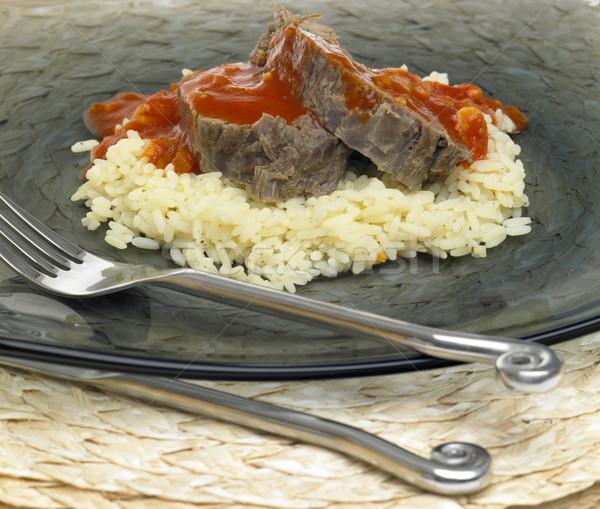 Carne de vacuno carne salsa de tomate alimentos tenedor arroz Foto stock © phbcz