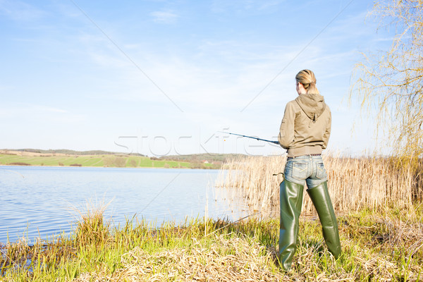 woman fishing at a pond Stock photo © phbcz
