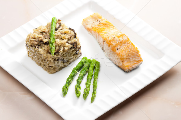 baked salmon with mushroom risotto and green asparagus Stock photo © phbcz