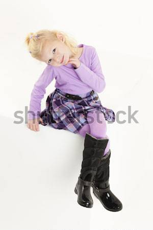 Seduta bambina indossare gonna ragazza bambino Foto d'archivio © phbcz