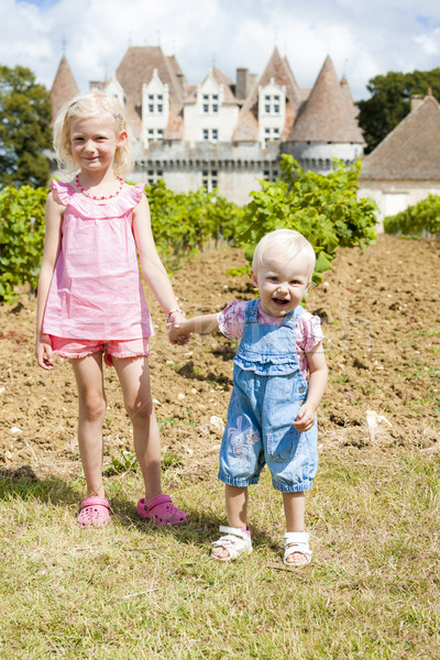 two little girls in front of Monbazillac Castle, Aquitaine, France Stock photo © phbcz