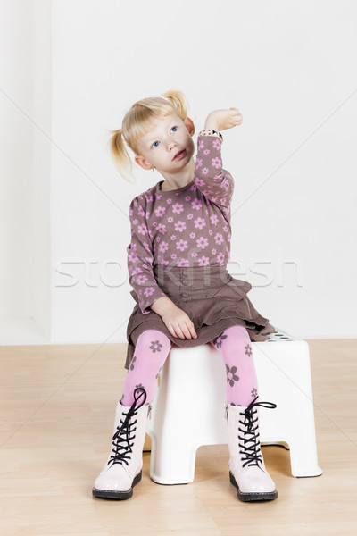 sitting little girl with a bracelet Stock photo © phbcz