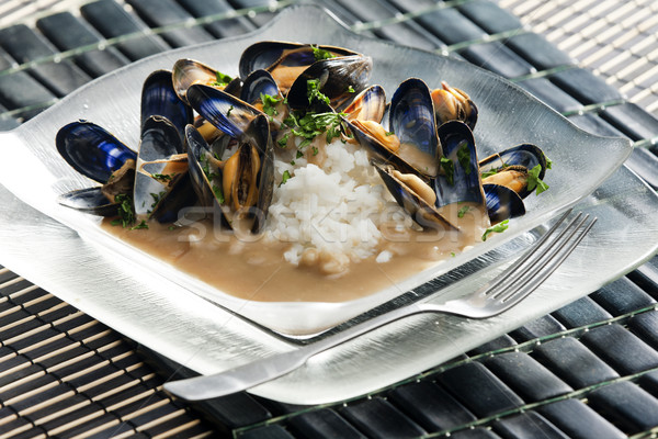 mussels on curry paste Stock photo © phbcz