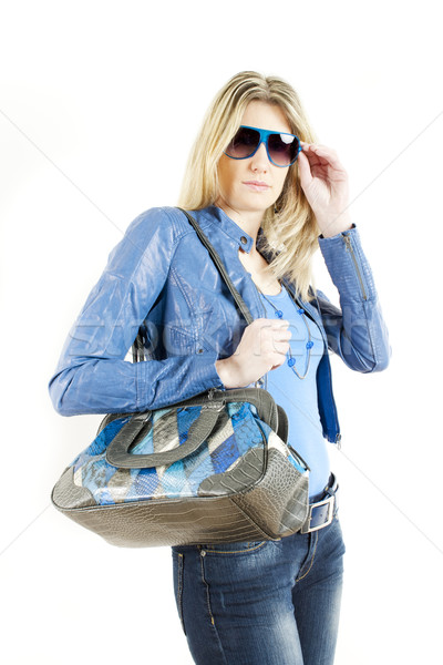 portrait of standing woman wearing blue clothes with handbag Stock photo © phbcz