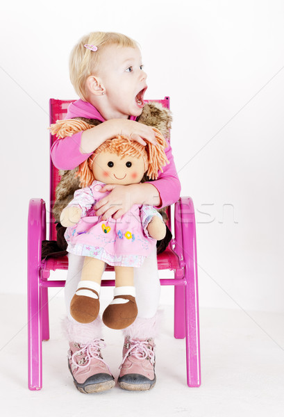 little girl playing with a doll Stock photo © phbcz