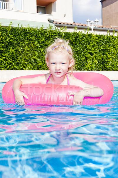 Bambina gomma anello piscina acqua ragazza Foto d'archivio © phbcz