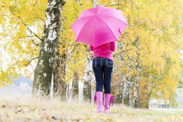 Donna indossare stivali di gomma ombrello natura Foto d'archivio © phbcz