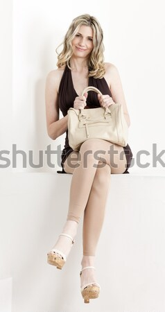Stock photo: woman wearing underwear standing on weight scale