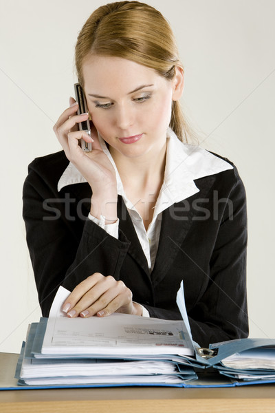 portrait of telephoning businesswoman with folders Stock photo © phbcz
