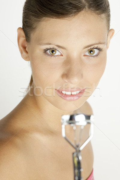 portrait of young woman with eyelash tweezers Stock photo © phbcz