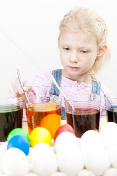 portrait of little girl during Easter eggs'' coloration Stock photo © phbcz