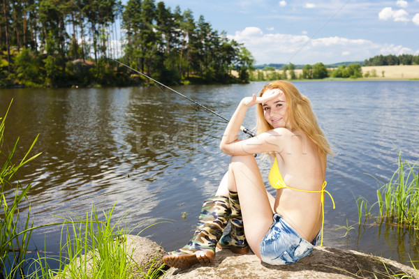 young woman fishing at pond in summer Stock photo © phbcz