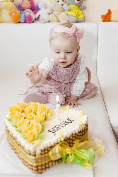 sitting toddler girl with her birthday cake Stock photo © phbcz