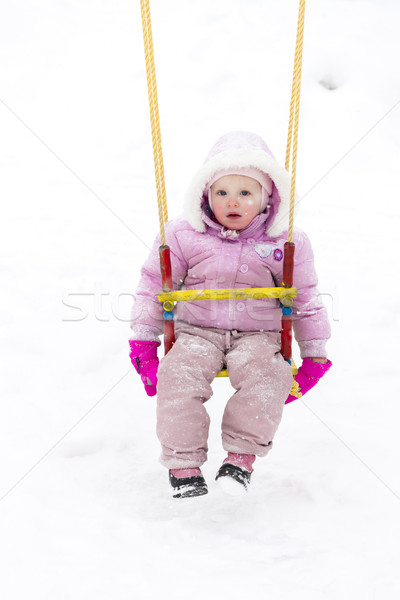 little girl sitting on swing in winter Stock photo © phbcz