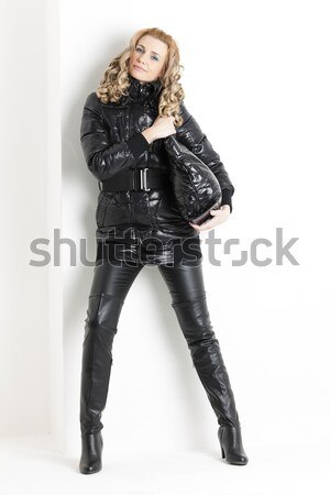 standing woman wearing black extravagant clothes and pumps Stock photo © phbcz
