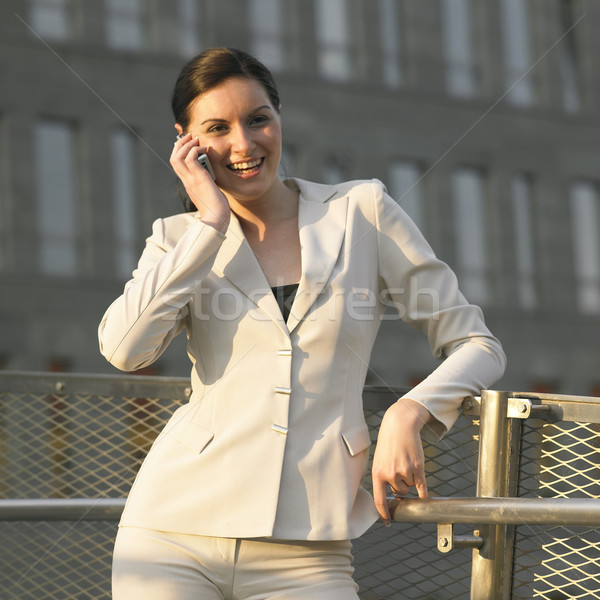 telephoning businesswoman Stock photo © phbcz