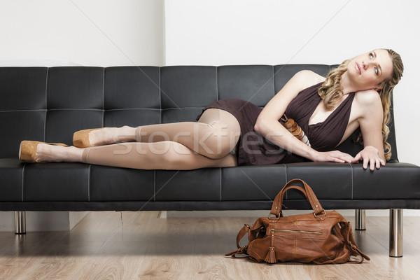 Nő visel kézitáska kanapé cipők személy Stock fotó © phbcz