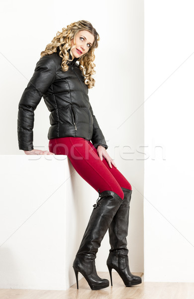 sitting woman wearing fashionable clothes with black boots Stock photo © phbcz
