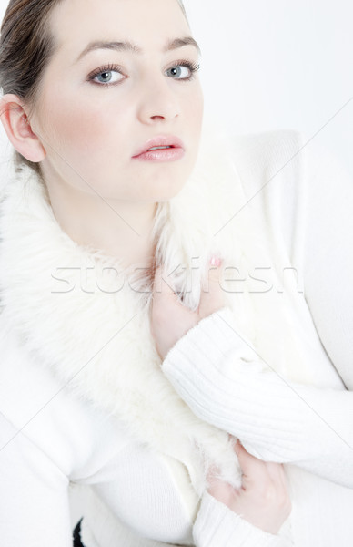 Stock photo: portrait of young woman wearing white sweater
