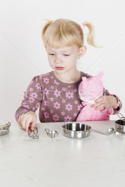 Little girl jogar criança prato boneca Foto stock © phbcz