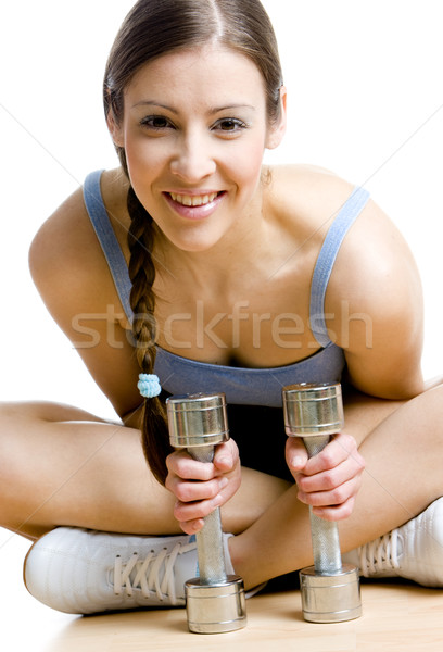 woman with dumb bells at gym Stock photo © phbcz