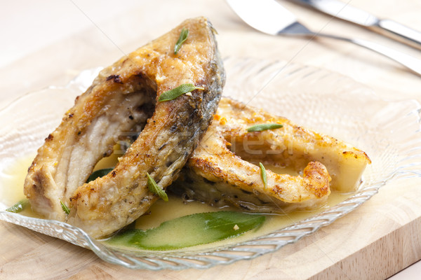 carp with butter and sage Stock photo © phbcz