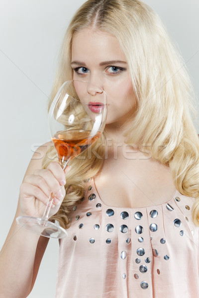 portrait of young woman drinking rose wine Stock photo © phbcz