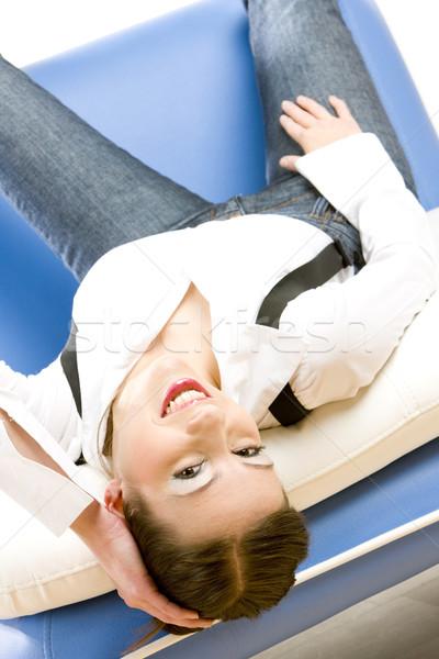 Kobieta sofa młodych sam młodzieży kobiet Zdjęcia stock © phbcz