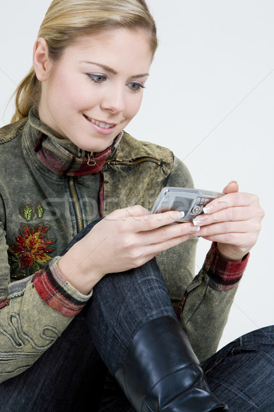 portrait of woman with mobile phone Stock photo © phbcz