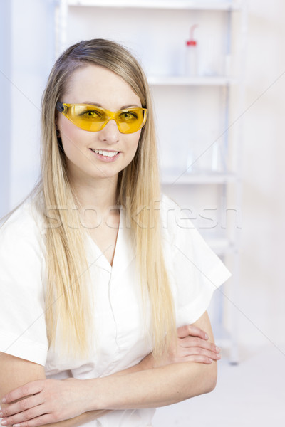 portrait of young woman with protective glasses in laboratory Stock photo © phbcz
