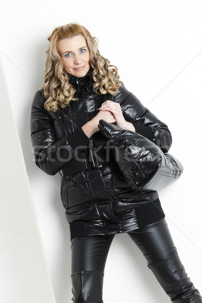 portrait of standing woman in black clothes with a handbag Stock photo © phbcz