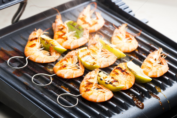 prawn skewers with lime on electric grill Stock photo © phbcz