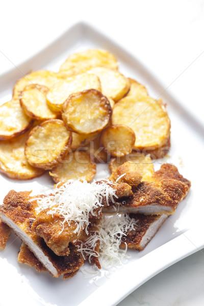 Frito parmesão carne de porco filé batatas queijo Foto stock © phbcz