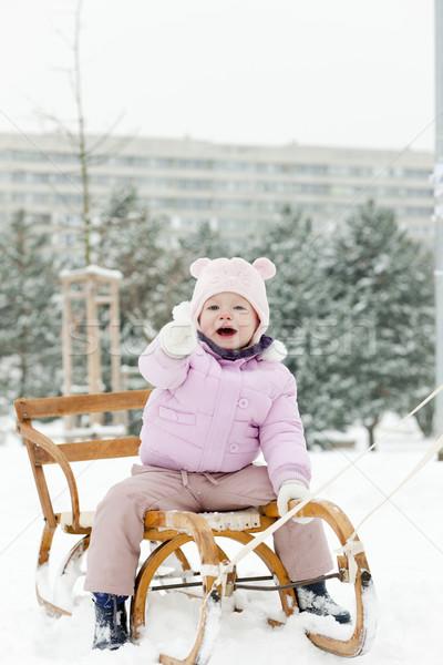 little girl sledding in snow Stock photo © phbcz