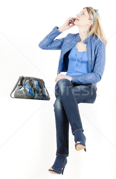 ül nő mobiltelefon kézitáska telefon szemüveg Stock fotó © phbcz