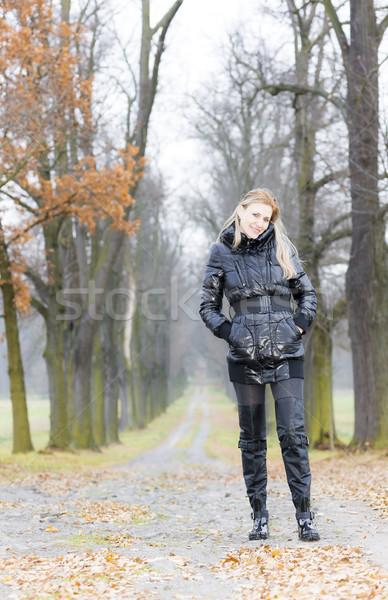 Kobieta czarny ubrania buty jesienny Zdjęcia stock © phbcz