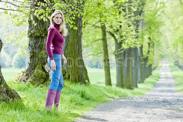 woman wearing rubber boots in spring alley Stock photo © phbcz