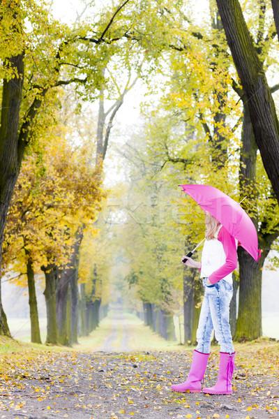 Nő visel gumicsizma esernyő őszi sikátor Stock fotó © phbcz