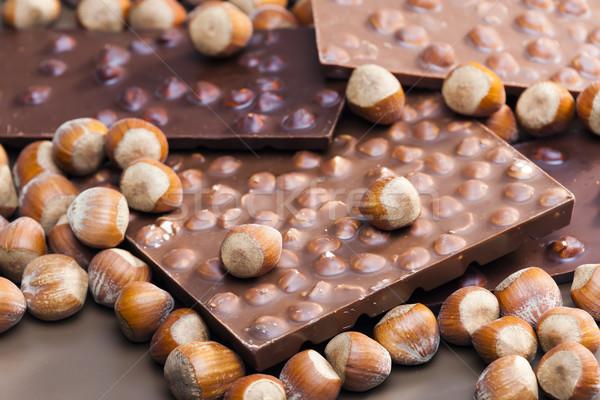 Csokoládé rácsok mogyoró háttér édes bent Stock fotó © phbcz