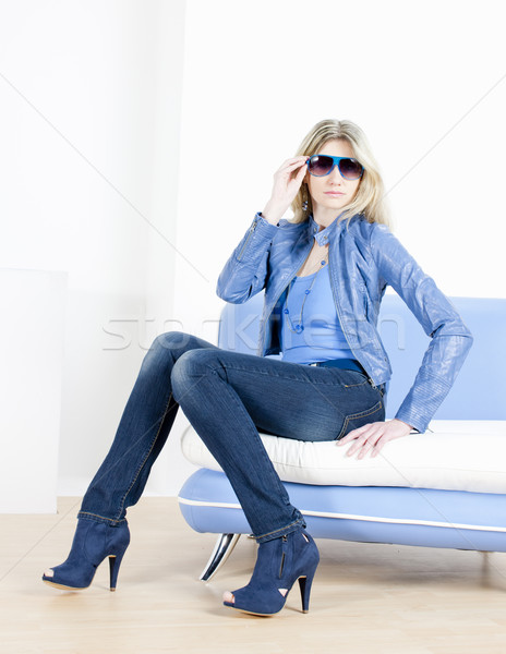 woman wearing blue clothes sitting on sofa Stock photo © phbcz