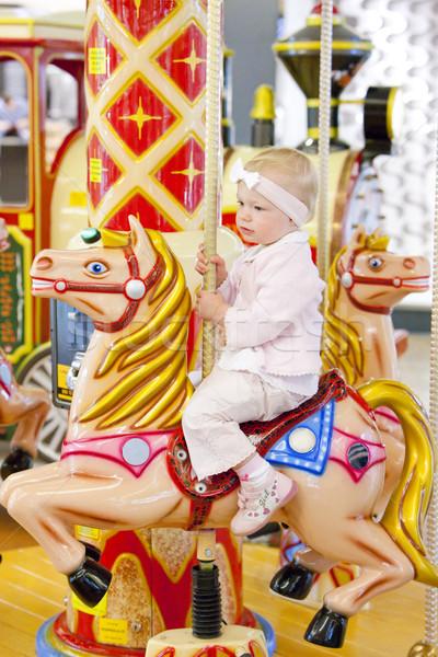 sitting toddler on carousel Stock photo © phbcz